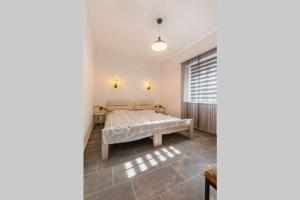 A bed or beds in a room at Apartment Amula