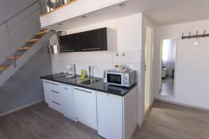 A kitchen or kitchenette at Downtown Apartments Pula