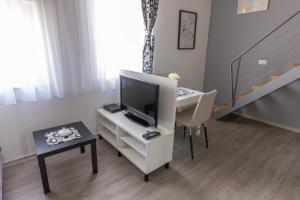 A television and/or entertainment center at Downtown Apartments Pula