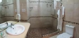 A bathroom at Premier Compass Hotel Kherson