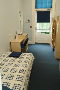 A bed or beds in a room at FSC Preston Montford Hostel
