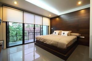Un ou plusieurs lits dans un hébergement de l'établissement Gord Chiang Mai