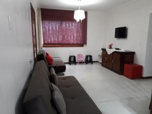 A seating area at Novo Aconchego