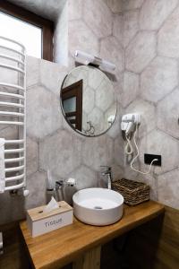 Ванна кімната в GOOD DAYS Shale Resort 4 км до Буковеля