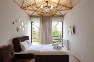 Ліжко або ліжка в номері GOOD DAYS Shale Resort 4 км до Буковеля
