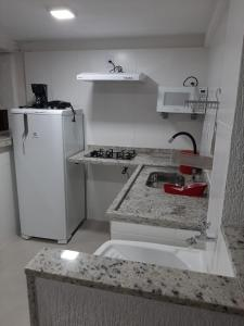 A kitchen or kitchenette at Bugio Flats