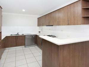 A kitchen or kitchenette at Hidden Gem On Manning - Great location opposite Surf Beach