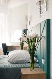 Кровать или кровати в номере Алеон Отель