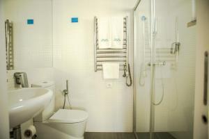 Uma casa de banho em Casa das Aguarelas - Apartamentos