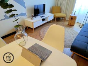 A television and/or entertainment center at PicPorto Apartment