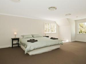A bed or beds in a room at Romney - location, tennis, billiards, fireplace