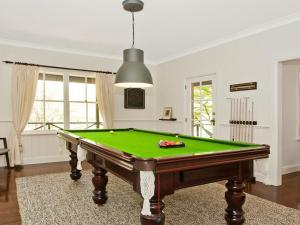 A pool table at Romney - location, tennis, billiards, fireplace