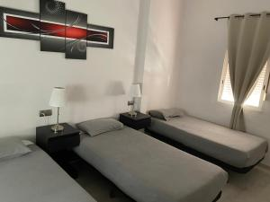 A bed or beds in a room at Apartamentos Turia