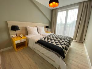 Posteľ alebo postele v izbe v ubytovaní B&B ALIBI