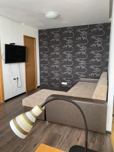 Кровать или кровати в номере Квартира с видом на Центральную Площадь Four Corners