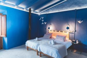A bed or beds in a room at Son Mesquida Vell