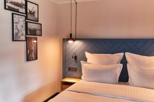 Ein Bett oder Betten in einem Zimmer der Unterkunft Steigenberger Conti Hansa