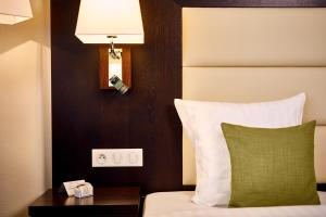 A bed or beds in a room at Hotel Charleroi Airport - Van Der Valk