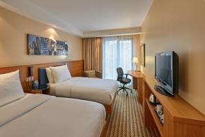 A television and/or entertainment centre at Hampton by Hilton Berlin City West