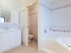 A bathroom at 2/141A Soldiers Point Road - large waterfront duplex across from the bowling club