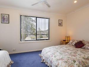 A bed or beds in a room at 2/141A Soldiers Point Road - large waterfront duplex across from the bowling club