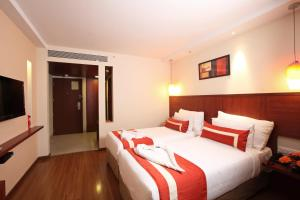 A bed or beds in a room at Octave Hotel & Spa - Sarjapur Road