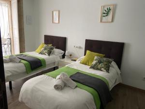 Cama o camas de una habitación en Pensión Residencia Fonseca