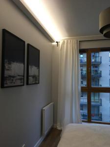 TV a/nebo společenská místnost v ubytování Apartament Zajezdnia Wrzeszcz - blisko plaży