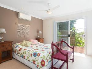 A bed or beds in a room at Serenity', 7 Mulloway Place - Peaceful house with air con Netflix & WIFI