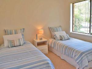 A bed or beds in a room at The Verandah', 9 Hanson Avenue - fantastic child friendly home
