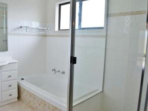A bathroom at The Verandah', 9 Hanson Avenue - fantastic child friendly home