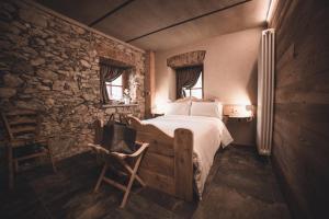 Letto o letti in una camera di Ca' Mea-Room and Wellness