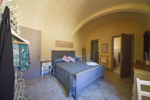 A bed or beds in a room at Il Sogno di Annalisa Suite