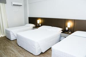 A bed or beds in a room at San Marino Cassino Hotel