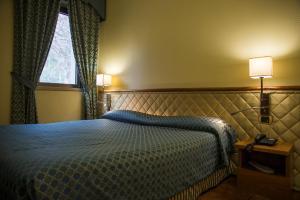 Letto o letti in una camera di Hotel Giubileo