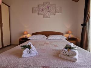 Posteľ alebo postele v izbe v ubytovaní Apartments Marija