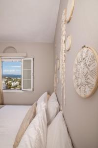 Ein Bett oder Betten in einem Zimmer der Unterkunft Porto Vidali