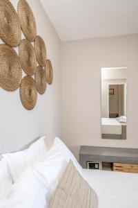 Ένα ή περισσότερα κρεβάτια σε δωμάτιο στο Porto Vidali