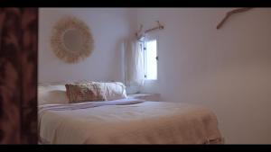 Ein Bett oder Betten in einem Zimmer der Unterkunft Amayour Surf Hostel