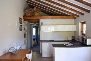 Una cocina o zona de cocina en Apartamento El Olivo