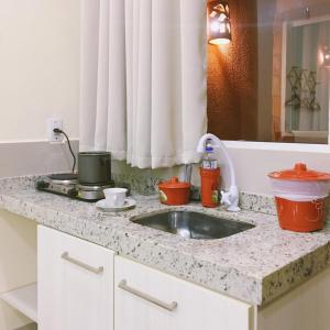 A kitchen or kitchenette at Cuiabá House & Hostel
