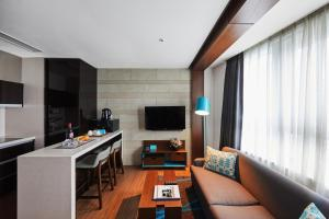 A television and/or entertainment center at Felix by STX Hotel & Suite
