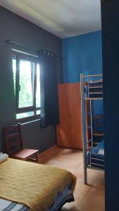A bunk bed or bunk beds in a room at Kortarixar
