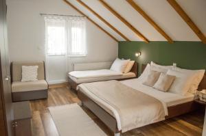 Postel nebo postele na pokoji v ubytování Guesthouse Rubcic