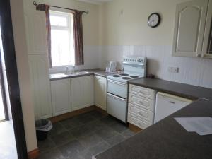 A kitchen or kitchenette at Carnside Guest House