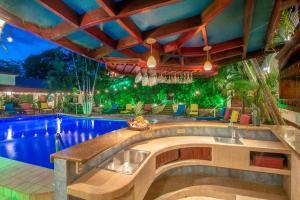 The swimming pool at or near Hotel Villas Lirio