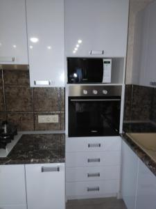 A kitchen or kitchenette at Business Apartment Griboyedova 31