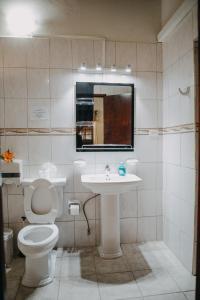 Um banheiro em 10 MINUTES THE EAGLE BEACH