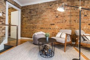 A seating area at Chippendale · Quaint 1880's Sydney Chippendale Terrace House