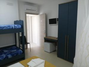 A bunk bed or bunk beds in a room at Hotel Tirreno Formia accetta bonus vacanza